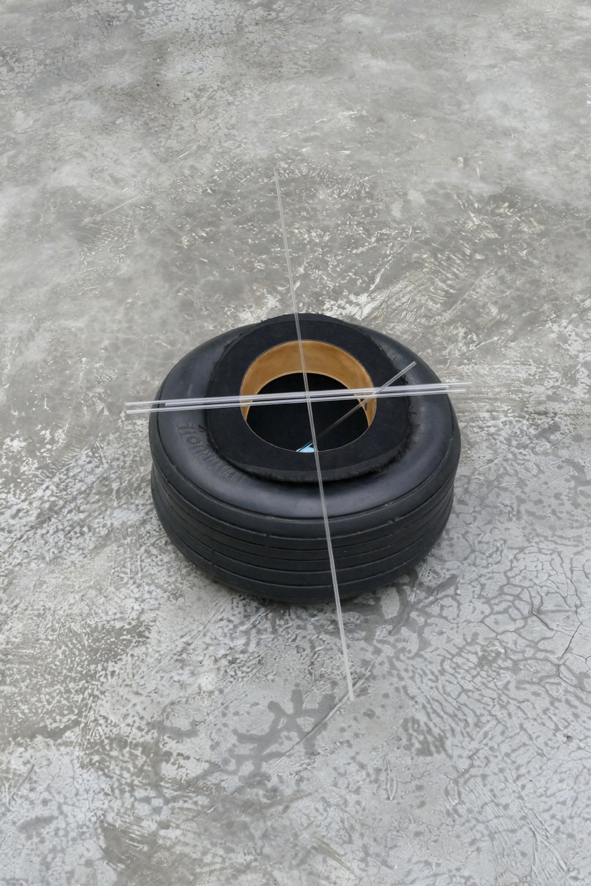 'Compas [Nocturne]' – 2020. rubber (tire), felt (bowler hat), glass (tubes 4mm), white-blue marble. sizes: 23 h x 91,5 x 41 cm.